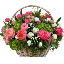 Basket of peonies, hydrangeas, roses